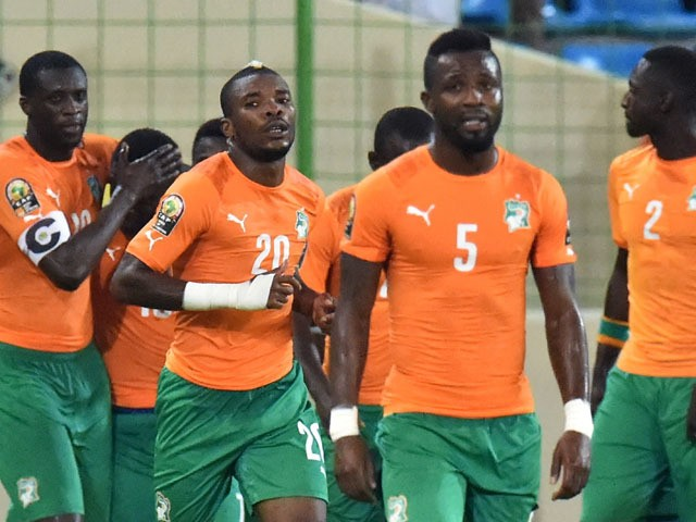 Ivory Coast's players celebrate after scoring a goal during the 2015 African Cup of Nations group D football match between Cameroon and Ivory Coast in Malabo on January 28, 2015