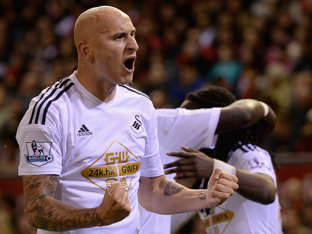Jonjo Shelvey of Swansea celebrates Marvin Emnes's opening goal during the Capital One Cup Fourth Round match against Liverpool on October 28, 2014