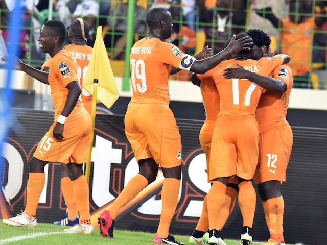 Ivory Coast's forward Wilfried Bony (R) is congratulated by teammates after scoring a goal during the 2015 African Cup of Nations quarter final football match against Algeria on February 1, 2015