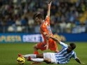 Valencia's defender Jose Gaya (L) vies with Malaga's forward Samuel Garcia Sanchez during the Spanish league football match on February 2, 2015
