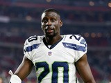 Cornerback Jeremy Lane #20 of the Seattle Seahawks walks off the field after defeating the Arizona Cardinals 35-6 in the NFL game at the University of Phoenix Stadium on December 21, 2014