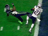 Malcolm Butler #21 of the New England Patriots intercepts a pass by Russell Wilson #3 of the Seattle Seahawks intended for Ricardo Lockette #83 late in the fourth quarter during Super Bowl XLIX at University of Phoenix Stadium on February 1, 2015