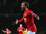 Juan Mata of Manchester United celebrates scoring the opening goal during the FA Cup Fourth round replay match between Manchester United and Cambridge United at Old Trafford on February 3, 2015