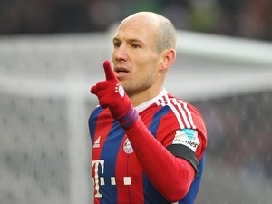 Bayern Munich's Dutch midfielder Arjen Robben celebrates scoring the first goal during the German first division Bundesliga football match against VfB Stuttgart on February 7, 2015