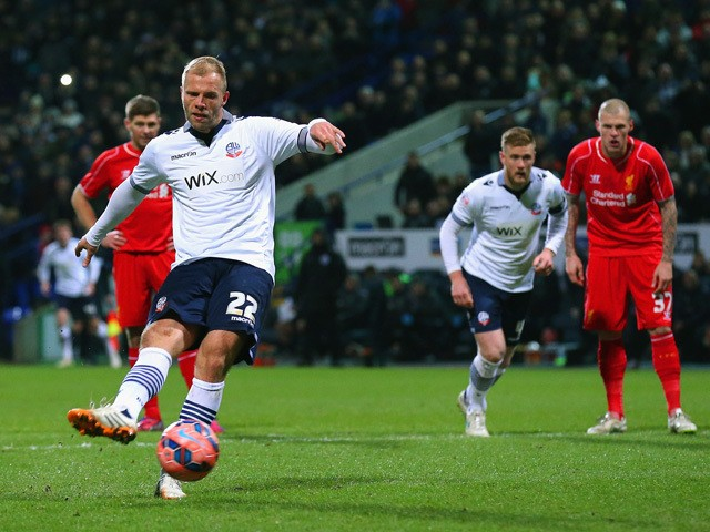 Eidur Gudjohnsen of Bolton Wanderers scores the opening goal from the penalty spot during the FA Cup Fourth round replay between Bolton Wanderers and Liverpool at Macron Stadium on February 4, 2015