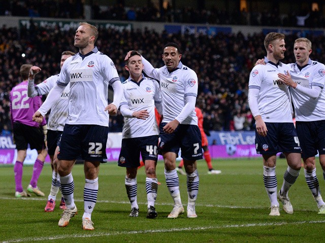 Bolton's Icelandic striker Eidur Gudjohnsen celebrates after scoring his team's first goal from a penalty during the FA Cup fourth round replay football match between Bolton and Liverpool at the Reebok Stadium in Bolton, on February 4, 2015
