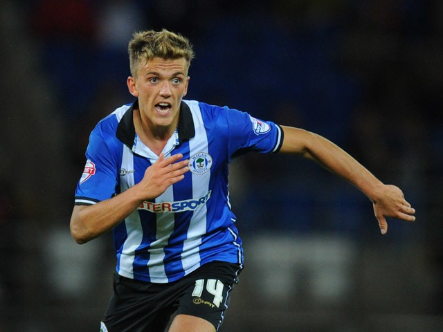 Wigan player Emyr Hughes in action during the Sky Bet Championship match between Cardiff City and Wigan Athletic at Cardiff City Stadium on August 19, 2014