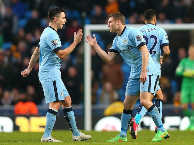 James Milner (R) of Manchester City celebrates scoring the equalising goal with team-mate Samir Nasri during the Barclays Premier League match against Hull on February 7, 2015