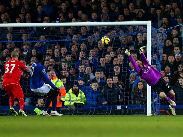 Simon Mignolet of Liverpool makes a save during the Barclays Premier League match between Everton and Liverpool at Goodison Park on February 7, 2015