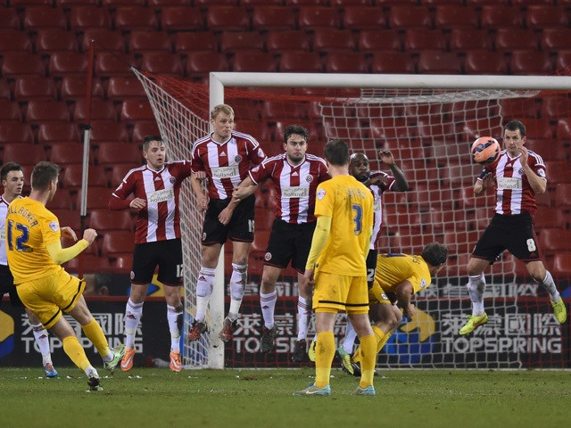Paul Gallagher of Preston scores a free kick to make it 1-1 during the FA Cup Fourth Round match between Sheffield United and Preston North End at Bramall Lane on February 3, 2015