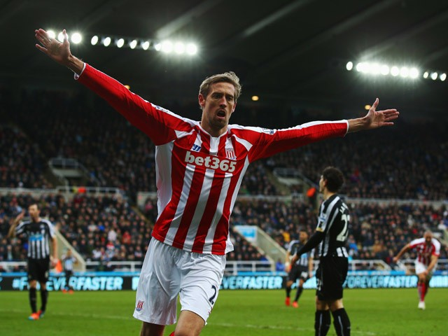 Peter Crouch of Stoke City celebrates as he scores their first and equalising goal during the Barclays Premier League match between Newcastle United and Stoke City at St James' Park on February 8, 2015