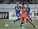 Lorient's French-Algerian midfielder Walid Mesloub vies for the ball with Lyon's French midfielder Maxime Gonalons during the French L1 football match between Lorient (FCL) and Lyon (OL) on February 15, 2015