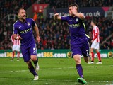 James Milner of Manchester City celebrates with team-mate Pablo Zabaleta after scoring his team's second goal during the Barclays Premier League match against Stoke on February 11, 2015