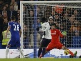 Chelsea's Czech goalkeeper Petr Cech (R) saves a shot by Everton's Belgian striker Romelu Lukaku during the English Premier League football match on February 11, 2015