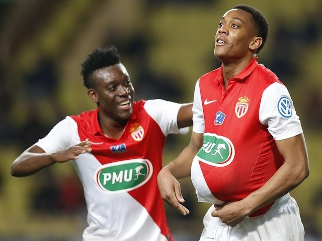 Monaco's French forward Anthony Martial (R) celebrates after scoring a goal with teammate midfielder Alain Traore of Burkina Faso during the French Cup football match on February 11, 2015