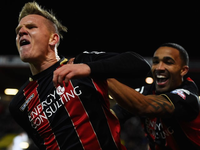 Matt Ritchie of Bournemouth celebrates with Callum Wilson as he scores their first goal during the Sky Bet Championship match between AFC Bournemouth and Derby County at Goldsands Stadium on February 10, 2015