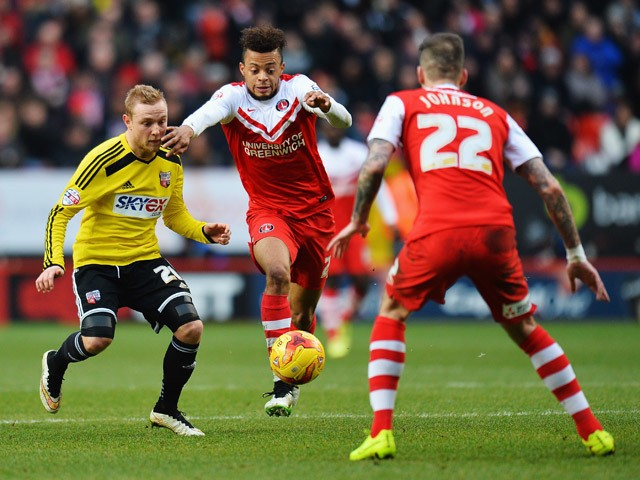 Jordan Cousins of Brentford shakes off the challenge of Alex Pritchard of Charlton Athletic during the Sky Bet Championship match between Charlton Athletic and Brentford at The Valley on February 14, 2015