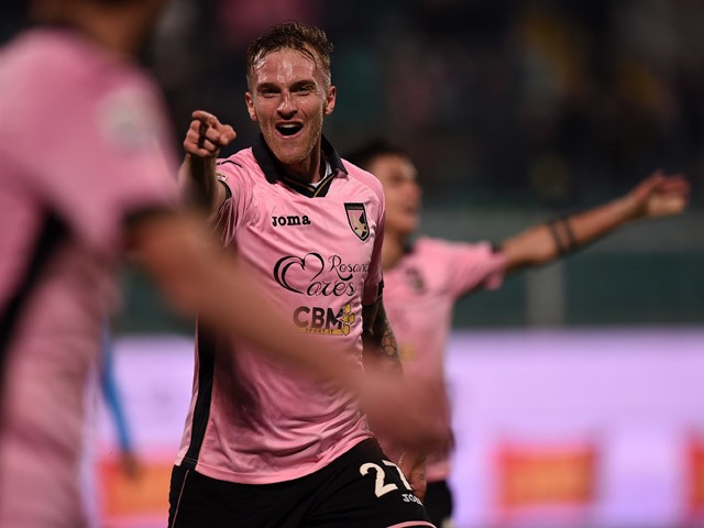 Luca Rigoni of Palermo celebrates after scoring his team's third goal during the Serie A match between US Citta di Palermo and SSC Napoli at Stadio Renzo Barbera on February 14, 2015