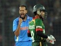 India cricketer Munaf Patel reacts after taking the wicket of Bangladesh cricket captain Shakib Al Hasan during the first match in the World Cup on February 19, 2011