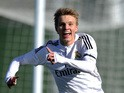 Martin Odegaard of Real Madrid Castilla celebrates after scoring his team's opening goal during the Segunda Division B match between Real Madrid Castilla v Barakaldo CF at estadio Alfredo Di Stefano on February 21, 2015 in