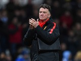 Manager Louis van Gaal of Manchester United applauds the fans during the FA Cup Fifth round match between Preston North End and Manchester United at Deepdale on February 16, 2015