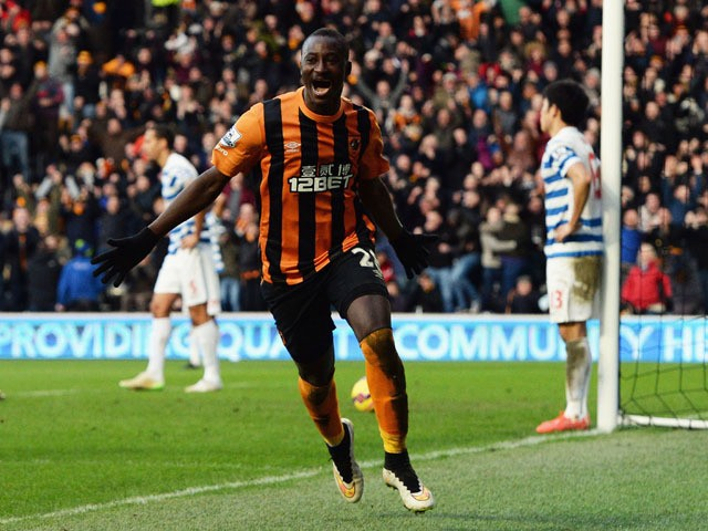 Dame N'Doye of Hull City (28) as he scores their second goal during the Barclays Premier League match between Hull City and Queens Park Rangers at KC Stadium on February 21, 2015