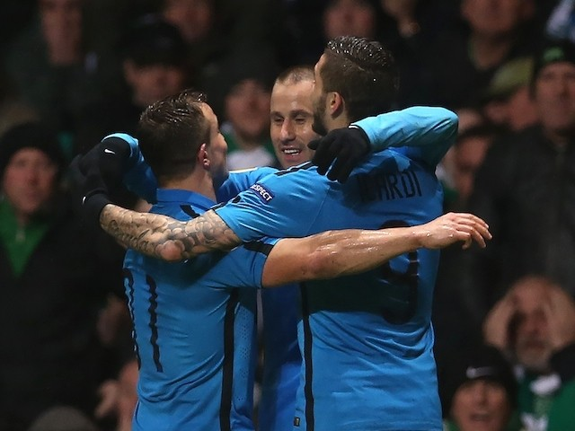 Inter Milan's Argentinan forward Rodrigo Palacio (C) celebrates scoring their third goal against Celtic on February 19, 2015