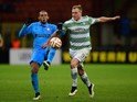 Juan of Inter Milan challenges John Guidetti of Celtic during the UEFA Europa League Round of 32 match on February 26, 2015
