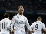 Real Madrid's Portuguese forward Cristiano Ronaldo celebrates after scoring on a penalty kick during the Spanish league football match Real Madrid CF vs Villarreal CF a