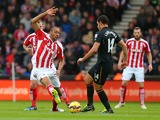 Steven N'Zonzi of Stoke City competes with Jake Livermore of Hull City during the Barclays Premier League match between Stoke City and Hull City at Britannia Stadium on February 28, 2015