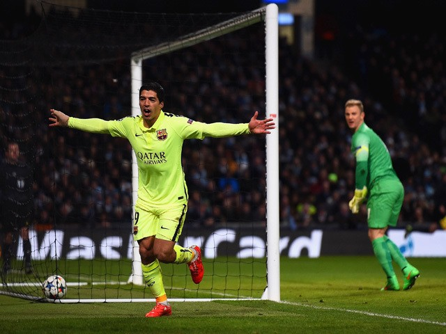 Luis Suarez of Barcelona celebrates scoring their second goal during the UEFA Champions League Round of 16 match between Manchester City and Barcelona at Etihad Stadium on February 24, 2015