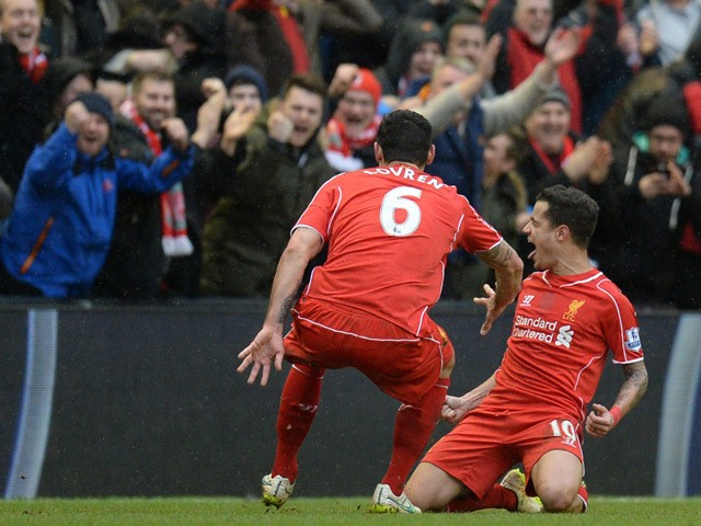 Liverpool's Brazilian midfielder Philippe Coutinho celebrates scoring their second goal in front of the Liverpool fans during the English Premier League football match between Liverpool and Manchester City at Anfield stadium in Liverpool, north west Engla