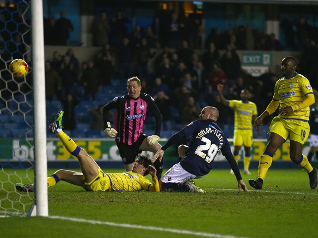 Gary Taylor-Fletcher of Millwall shoots at goal during the Sky Bet Championship match between Millwall and Sheffield Wednesday at The Den on February 24, 2015