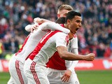 Anwar El-Ghazi of Ajax celebrates scoring the first goal of the game with Richairo Zivkovic and Daley Sinkgraven during the Dutch Eredivisie match between Ajax Amsterdam and SC Excelsior Rotterdam held at Amsterdam Arena on March 8, 2015