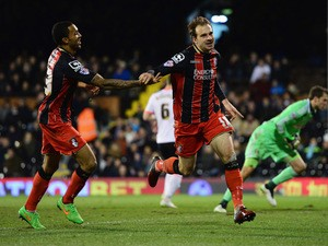 Brett Pitman of Bournemouth celebrates with Callum Wilson as he scores their third goal during the Sky Bet Championship match between Fulham and AFC Bournemouth at Craven Cottage on March 6, 2015