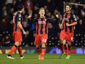 Matt Ritchie of Bournemouth (30) celebrates with team mates as he scores their second goal during the Sky Bet Championship match between Fulham and AFC Bournemouth at Craven Cottage on March 6, 2015