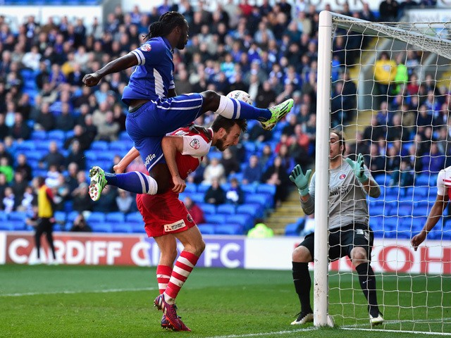 Cardiff City player Kenwyne Jones beats Morgan Fox of Charlton to the ball to set up the first goal during the Sky Bet Championship match between Cardiff City and Charlton Athletic at Cardiff City Stadium on March 7, 2015