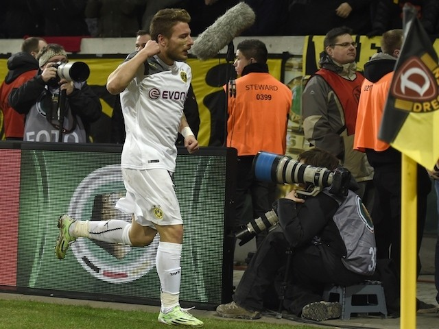 Dortmund's Italian striker Ciro Immobile celebrates after scoring the first goal during the German football Cup DFB Pokal round of 16 game between German third division against Dynamo Dresden on March 3, 2014