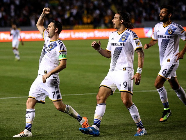 Robbie Keane #7 of the Los Angeles Galaxy celebrates with Alan Gordon #9 and Baggio Husidic #6 after scoring the Galaxy's second goal in the second half against the Chicago Fire at StubHub Center on March 6, 2015