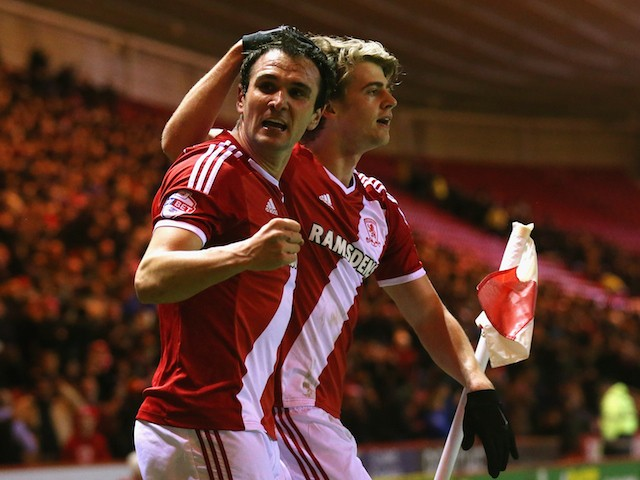 Patrick Bamford of Middlesbrough celebrates scoring the opening goal with Enrique Garcia during the Sky Bet Championship match against Millwall on March 3, 2015