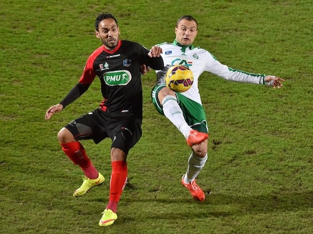 Saint Etienne's French midfielder Yohan Mollo (R) vies for the ball with Boulogne's midefielder Anthony Soubervie during the French Cup football match on March 3, 2015