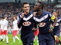 Bordeaux's French Senegalese defender Lamine Sane celebrates with a teammate after scoring a goal during the French L1 football match between Bordeaux (FCGB) and Paris-Saint-Germain (PSG) on March 15, 2015