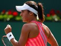 Heather Watson of Great Britain celebrates winning the first set against Agnieszka Radwanska of Poland during day seven of the BNP Paribas Open tennis on March 15, 2015