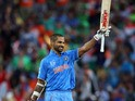 India's Shikhar Dhawan celebrates his century during the Pool B Cricket World Cup match between India and Ireland at Seddon Park in Hamilton on March 10, 2015