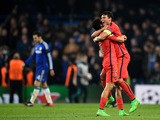 Marquinhos of PSG and Thiago Silva of PSG celebrate following their team's victory during the UEFA Champions League Round of 16, second leg match between Chelsea and Paris Saint-Germain at Stamford Bridge on March 11, 2015