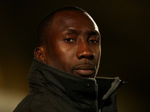 Burton manager Jimmy Floyd Hasselbaink looks on ahead of the Sky Bet League Two match between Wycombe Wanderers and Burton Albion at Adams Park on November 17, 2014