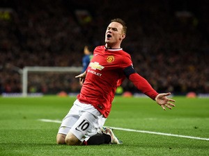 Wayne Rooney of Manchester United celebrates after scoring a goal to level the scores at 1-1 during the FA Cup Quarter Final match between Manchester United and Arsenal at Old Trafford on March 9, 2015