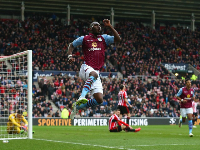 Christian Benteke of Aston Villa celebrates scoring their fourth goal during the Barclays Premier League match between Sunderland and Aston Villa at Stadium of Light on March 14, 2015