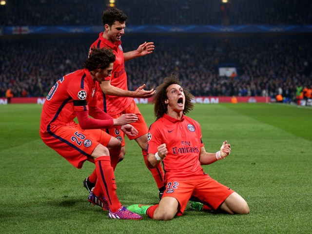 David Luiz of PSG celebrates after scoring a goal to level the scores at 1-1 during the UEFA Champions League Round of 16, second leg match between Chelsea and Paris Saint-Germain at Stamford Bridge on March 11, 2015