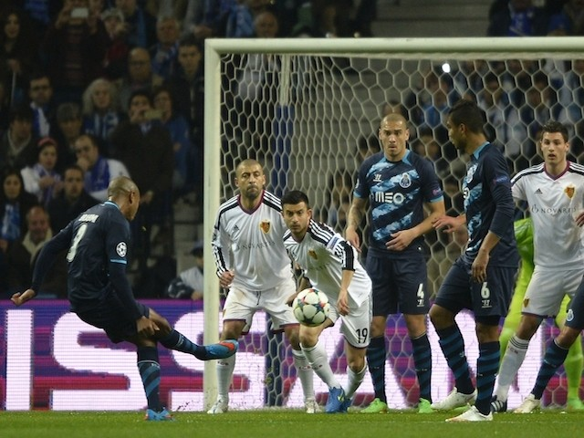 Porto's Algerian midfielder Yacine Brahimi (L) kicks the ball to score a goal during the UEFA Champions League round of 16 second leg football match against Basel on March 10, 2015